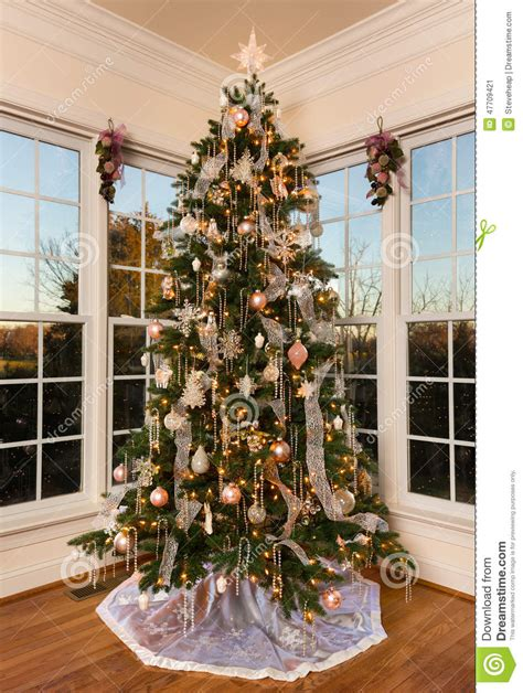decorated christmas tree in modern family room stock image