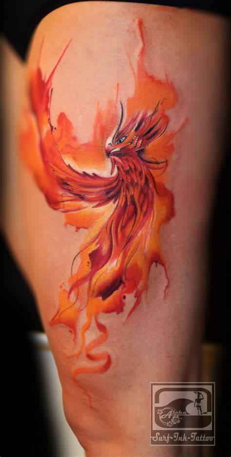 orange watercolor phoenix tattoo on thigh