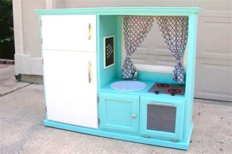 play kitchen from old furniture her old tv cabinet was useless until she transformed it
