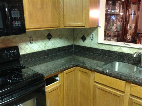 kitchen countertops and backsplashes donna s brown granite kitchen countertop w travertine backsplash granix