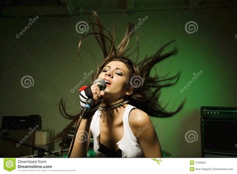 mics are for singing not swinging female singing into mic stock images image 2768364