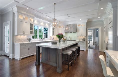 White kitchen cabinets with gray kitchen island transitional kitchen