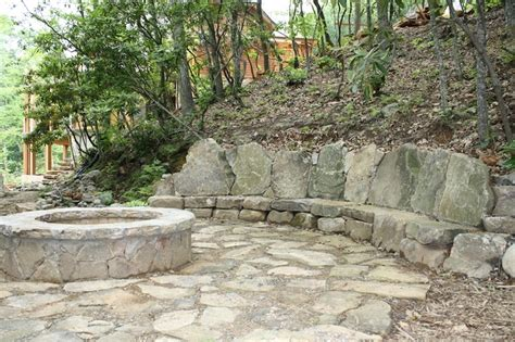 rustic flagstone patio with firepit cobblestones from