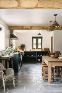 country floor a stylish country kitchen by devol with worn grey limestone flooring by floors of cook