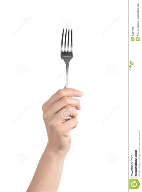 Beautiful Flatware by Woman Hand Holding Up A Fork Royalty Free Stock Photos