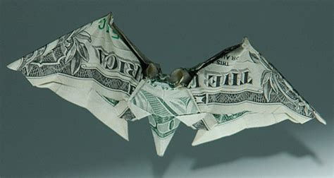 Catfish Dollar Origami - dollar bill origami artist lives in a garbage truck