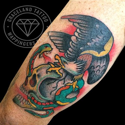 traditional tattoo eagle and snake traditional skull eagle and snake tattoo by adam