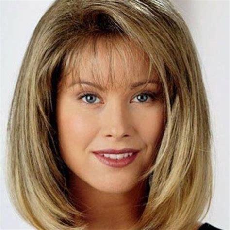 shoulder sweep haircuts women long layered bob with side swept bangs long layered bob