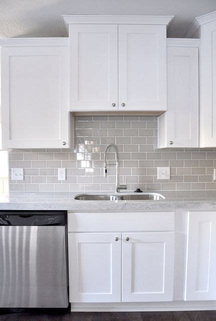 white kitchen shaker cabinets smoke glass subway tile grey subway tiles grey and glasses