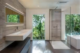 Modern master bathroom with wall sconce amp limestone tile