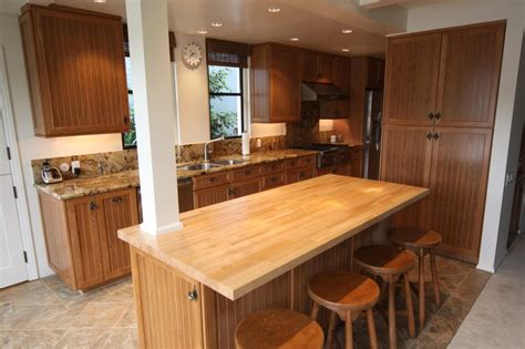 granite butchers block balboa island kitchen remodel cherry wood cabinets with