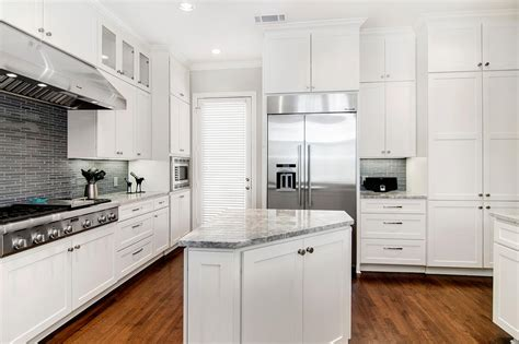 kitchen triangle with island white transitional chef s kitchen with triangular island