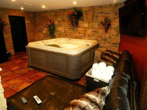 indoor tub room indoor room w 60 inch led t v on wall and wine cellar tubs wine