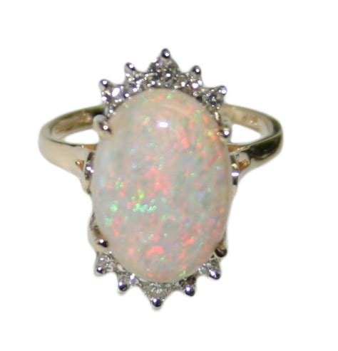 1550 Ct Jumbo Size Yellow Opal 14k yellow gold white opal and 0 20ct s ring size 6 25 tangible investments
