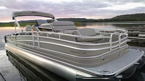 pontoon boat with cabin four innovative pontoon boats for 2016 boat trader