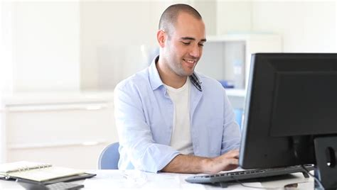 Office Workers by Office Worker Typing Report On Computer Stock Footage