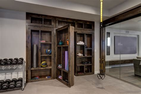 Basement Gym with Hidden Bookcase open Contemporary Home Gym Denver by Finished Basement