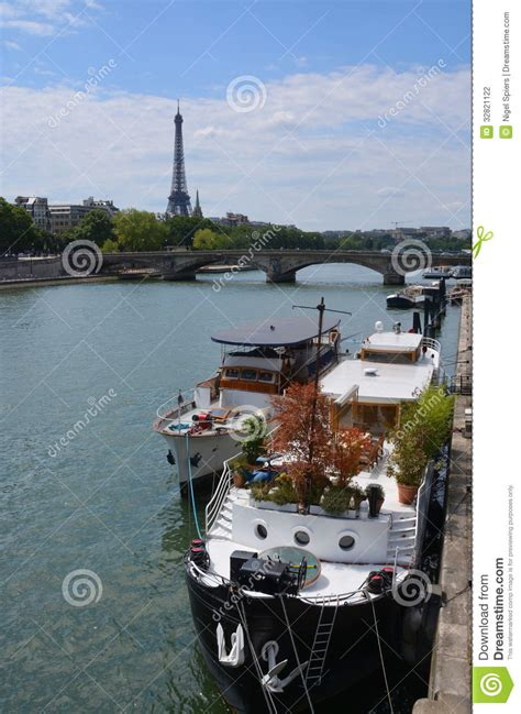 party boat paris party boats moored on the seine river with eiffel tower in