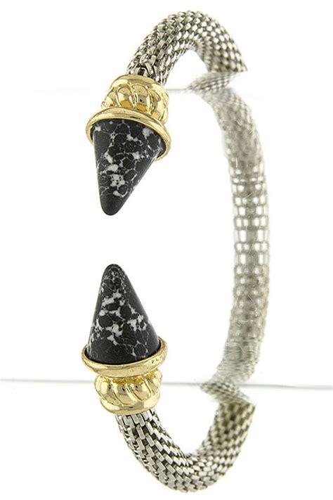 Smoky Gunmetal Adds Edge To A Chain Bracelet By Giles And Any From To Carpet Fashiontribes Fashion by Pointed Edge Snake Chain Cuff Bracelet