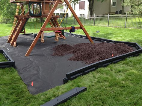 backyard playground mulch weed barrier borders and mulch under a playset for the home outside pinterest