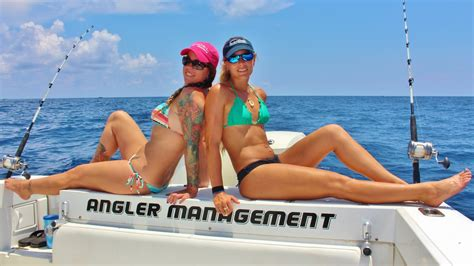 boat angel girl two girls offshore florida fishing and catching kingfish