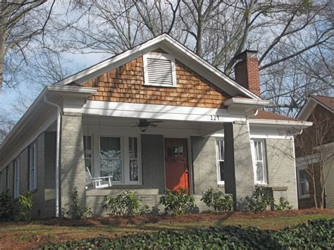warm gray with white trim and brown roof like the orange door exterior colors