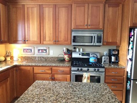 two tone cherry kitchen cabinets two tone cabinets cherry uppers and painted bases