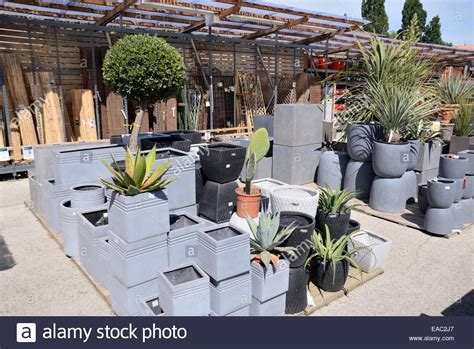 plant pots for sale display of gray or grey planters or plant pots for sale in garden stock photo royalty free