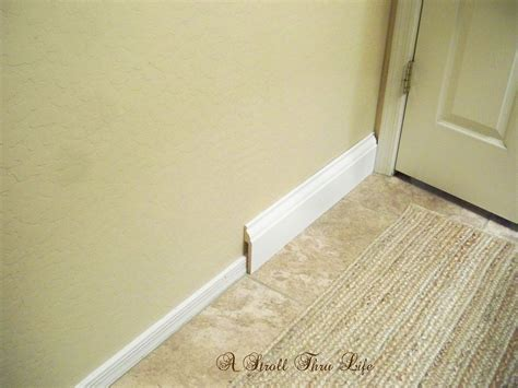 how to install baseboard trim in bathroom a stroll thru life install wide baseboard molding over