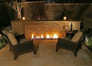 outdoor gas fireplace w herringbone brick lose the lawn