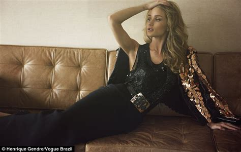 lorena sizzles as she poses on the bed wearing a hot black rosie huntington whiteley sizzles in golden hues as she