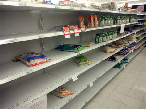 On The Shelf In Store by Bangkok Floods 2011 Supermarket Out Of Bottled Water And