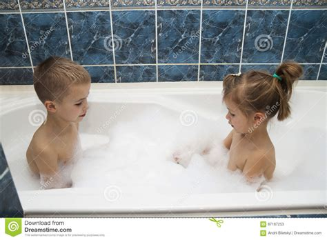 girls in bathroom with boys taking a bubble bath stock photo cartoondealer com 7811970