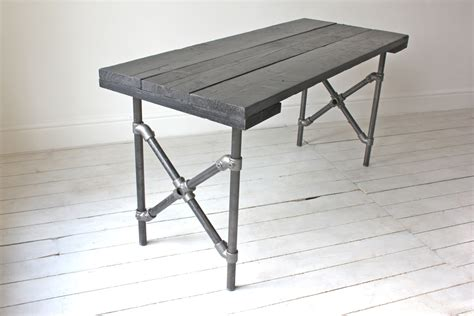 Pipe Dining Table Reclaimed Scaffolding Board Painted Black With Criss Cross Steel Legged Pipe Dining Table