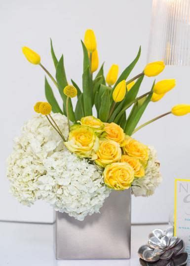 vibrant yellow centerpiece hydrangea roses and tulips gail s favourites floral arrangements