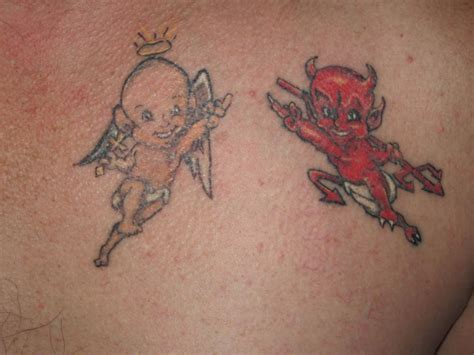 angel and devil tattoo and tattoos on right back shoulder