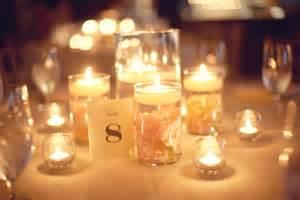 wedding reception table hurricane vases candles