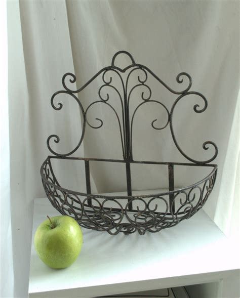 Wrought Iron Wall Planter by Rustic Wrought Iron Wall Mounted Planter Basket Modern