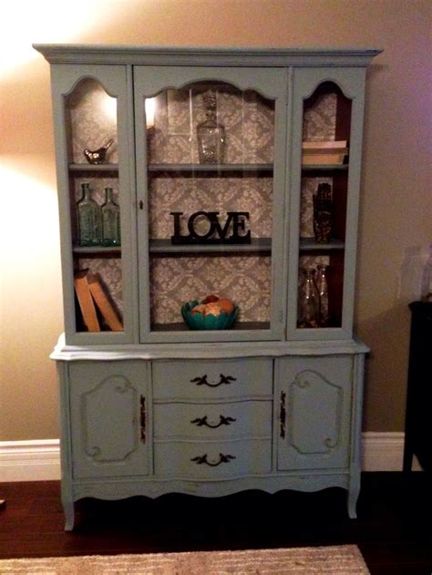 Refinish Kitchen Cabinet by Painted Out This Old Hutch And Added Wallpaper To The