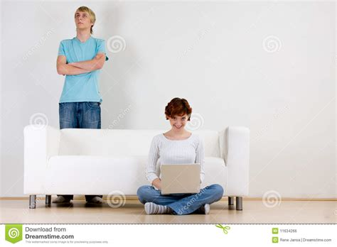 young couple room couple near sofa in room royalty free stock image image 11634266