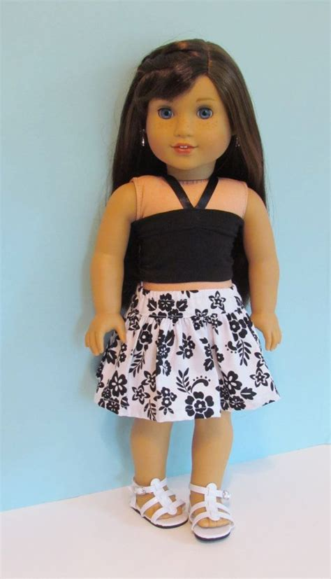 black doll show american doll black and white flowered skirt and