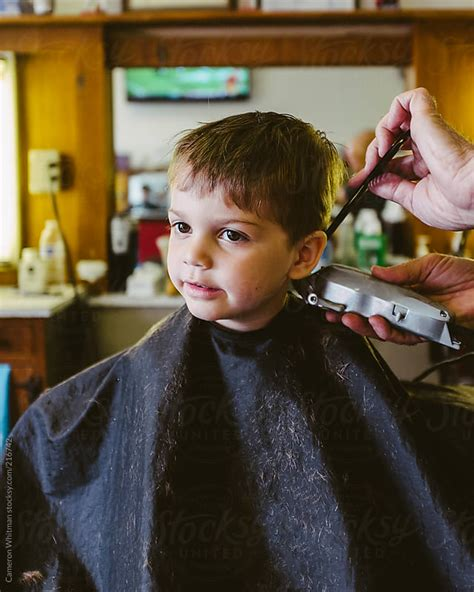 youtube young boys getting haircuts handsome young boy getting his haircut in a barbershop by