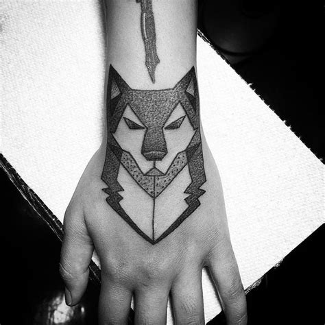 wolf tattoo wrist aztec wolf on wrist