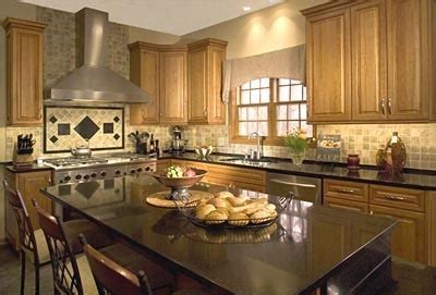 maple kitchen cabinets with granite countertops black granite countertops and maple cabinets and entertaining kitchen for two cooks transitional
