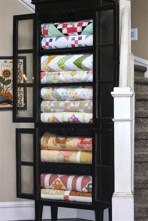 Blanket Storage Ideas by Sew Kind Of Wonderful Tuesday Tips Displaying Quilts