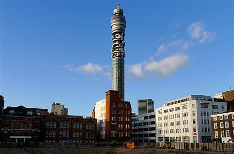 London at dusk: cranes, flags, Big Ben and the Telecom