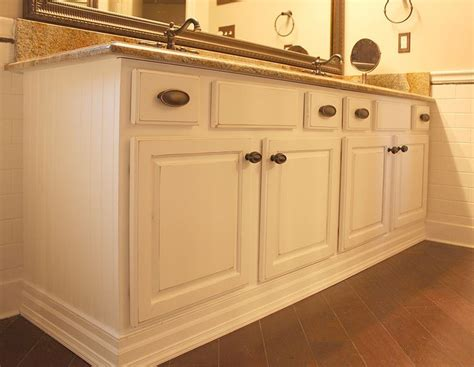how to reface cabinets with beadboard a distressed white lacquer finish transformed that