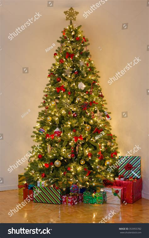 what is the main holiday decoration in most mexican homes decorated pine tree many presents under stock photo