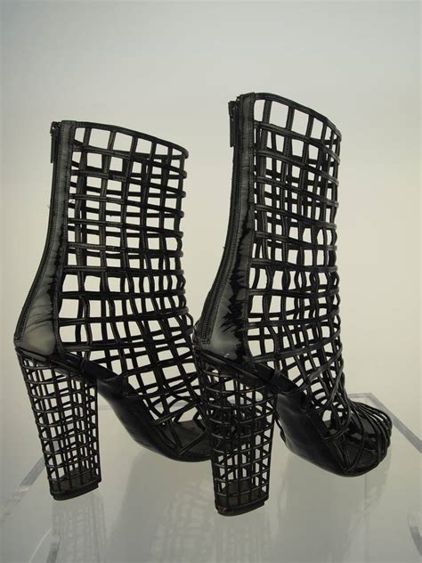 Wedges St Yves Mw 41 yves laurent black patent leather cage boot at 1stdibs