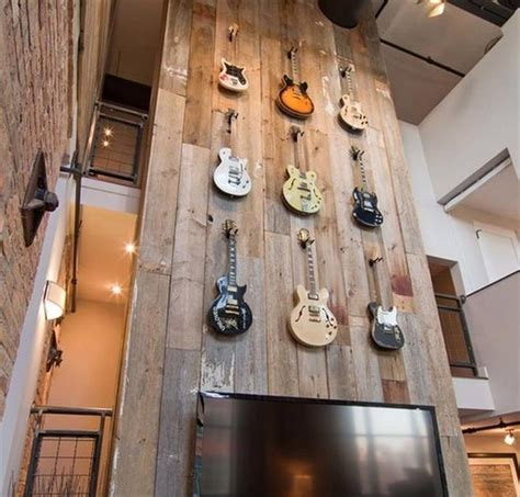 wood panel accent wall interiors pinterest guitars hanging from old pallet google search decor